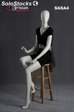Abstract female mannequin sitting pearl white