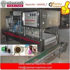 Coffee capsule filling and sealing machine