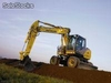 Escavadora de Rodas - NEW HOLLAND - MH PlusC