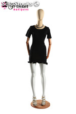 Faceless female mannequin with articulable arms